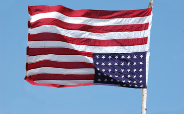 Iowa man arrested for flying American flag upside down.
