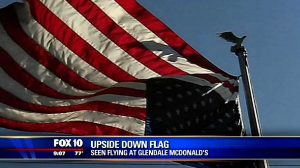 Army Veteran Hangs U.S. Flag Upside Down to Protest Eminent Domain